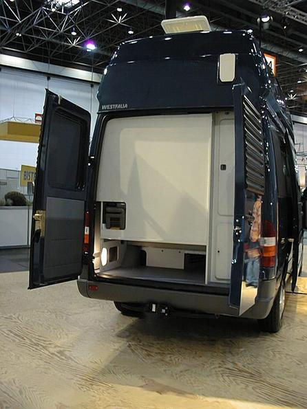 Bath in rear of a Mercedes Sprinter Behind the white wall is bath and toilette in the Westfalia Sprinter conversion. The toilette can be pulled out from behind.