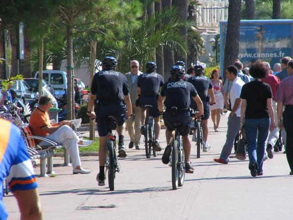 Bicycle police in Cannes The bicycle policemen appear completely astonishing there. So fast that I can photograph them only from the back. Such surprises are probably a horror for crooks.