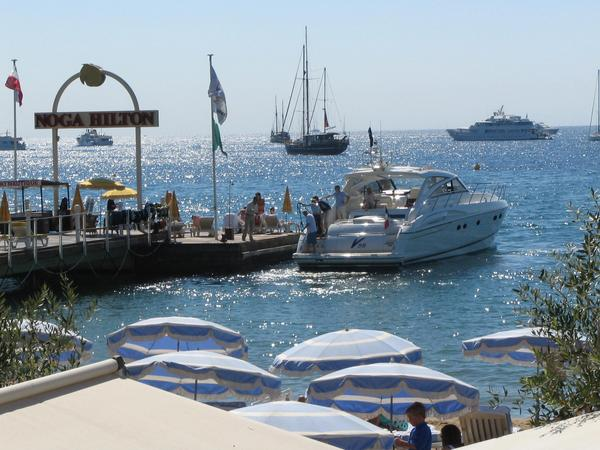 Hotel Noga Hilton Cannes. At jetty A yacht puts in in a jetty of the hotel Noga Hilton in Cannes