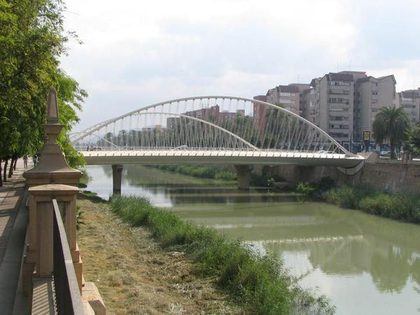 Bridge about the Segura in Murcia Several exactly same looking bridges are in Murcia in order to cross the river Segura. The water has on the 18th of September nearly 30 degrees and flows very slowly.