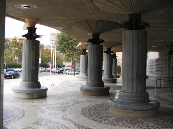 Columns from architect Gaudi The area before the entrance with the typical swung columns of Gaudi.