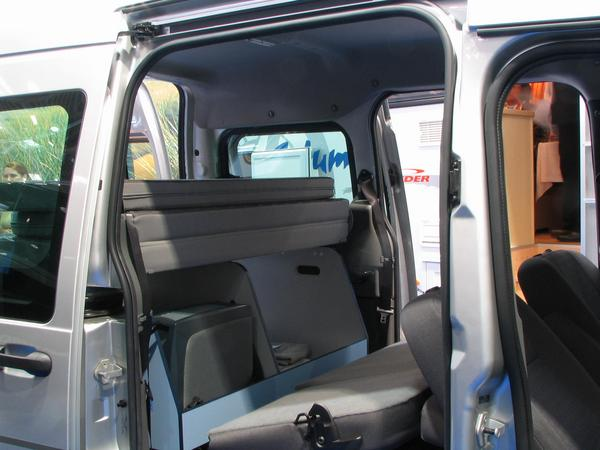 Ford Tourneo Connect Camping For the conversion to sleep, the back part of the seats in the middle row are folded forwards. To see behind it 3 mattresses for the bed construction.