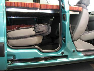 Renault Kangoo cuddy under bed To reach the necessary bed length the back parts of the front seats must be folded forwards. The bed is mounted rather high and allows a lot of cuddy under it. Picture 2