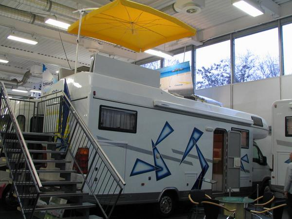 Alpha motorhome - the one with the solar terrace The staircases was put up behind, so that the fair visitors can simply throw a look at the roof terrace.