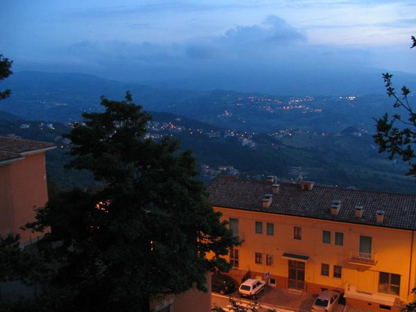 Evening mood in San Mraino The Titano mountains are the highest elevation in the visible vicinity. Look at the deeper situated land parts of San Marino in the late dusk.