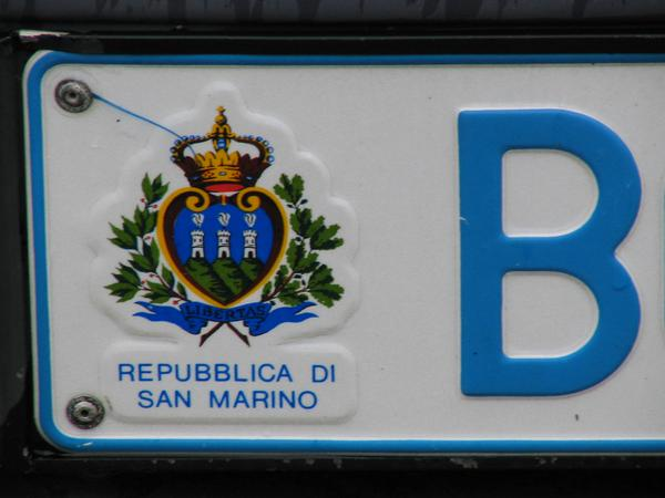 Car license plate San Marino RSM The coat of arms of San Marino with 3 towers of the fortress on the sign of a car.