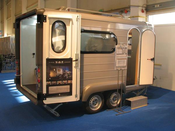 Combi trailer for for motorcycle and for camping Knaus with the YAT - Young Activity trailer shows a transporter for motorcycles and a caravan at the camper in Tulln in 2005
