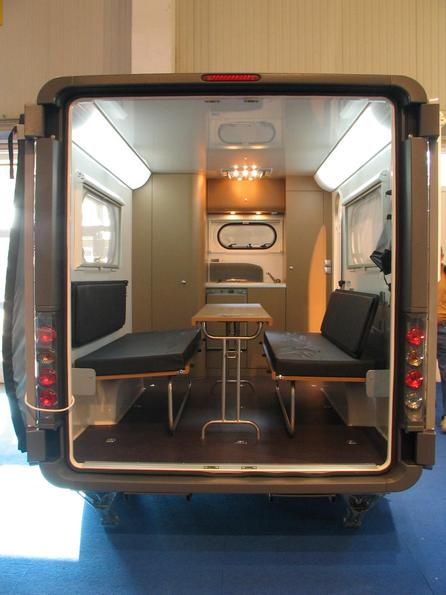 Caravans transporter combination The Knaus YAT Young Activity Trailer can be used as a caravan with 2 sleeping places. Wet cell, boxes and kitchen are in the front part.