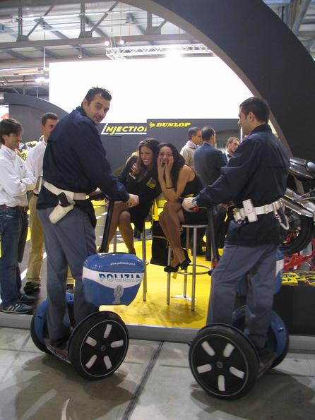 Milan police on Segway 2 policeman from Milan on police Sagways underway throgh the fair halls. Segway does not expose on the EICMA, but they had been well represented by the police vehicles.