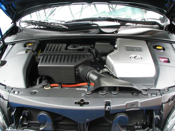 Toyota Lexus engine department Engine space comparison between Citroen C4 HDI Hybrid, Toyota Prius and Toyota Lexus. Typically for all of them is the voltage converter on the right side. (Lexus)
