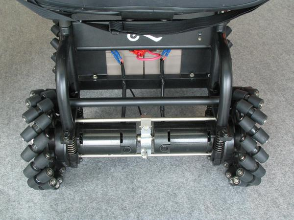 For every wheel own electric motor All 4 wheels of the wheel chair have an own electric motor. Besides, forward and backward the steering system let the rollers rotate free or blocks them.