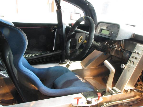 Biodiesel racing sport car cockpit Very spartan it in the Cockpit of the Peugeot RC cup biodiesel racing cars. The steering wheel is removable to the lighter entrance.