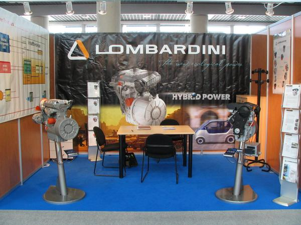 Lombardini generators for serial hybrid cars How does one extend the reach of an electric car? Instead of more and more batteries one could also take a generator. The concept is called serial hybrid car.