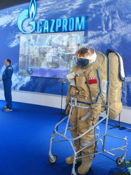 Russian spacesuit Gazprom shows the model of a russian orbiter, a spacesuit and a cosmonaut as attractions on their booth.
