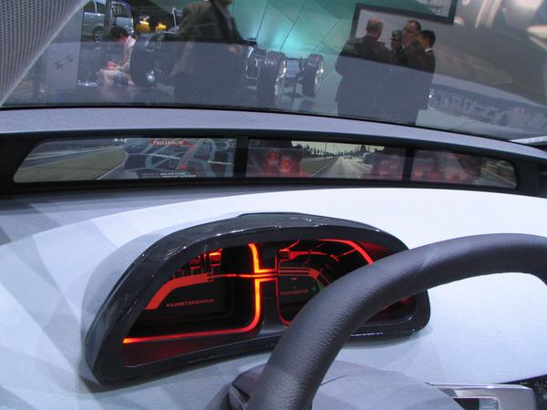 Instruments in the Opel Flextreme In front is a flat screen over the full interior width. The screen shows mainly the pictures from the left, middle and right rear view camera.
