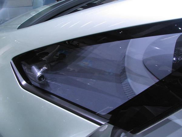 Opel Flextreme without side mirrors Because of the aerodynamic optimization, there are no more side mirrors. Instead of a side mirror are in the fron part of the front side window is a camera installed.