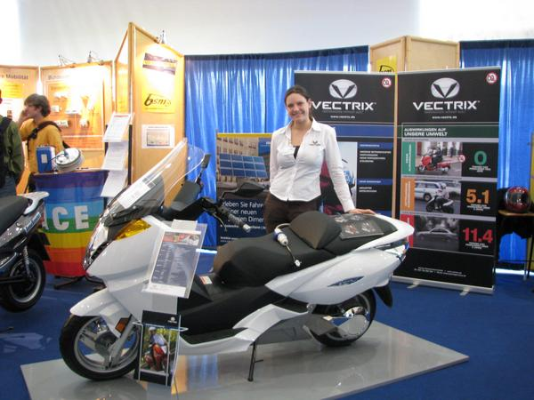 Vectrix now available in Berlin Germany Since Autumn 2007, it's possiible to purchase the Vectrix maxi scooter also in Berlin, Germany. Here the booth on the Hannover industrial fair 2008