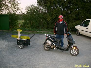 Model airplane hobby with electric scooter and trailer Some years ago, he changed his model airplanes to lithium polymer batteries. No he drives the way to the model airplane airport with an electric scooter and a trailer. Picture 1