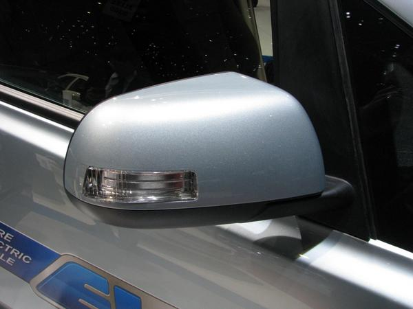 Side mirror with signal light Close up from the side mirror. It seems t