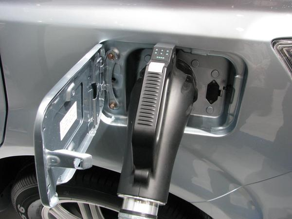 Fast charging plug in the socket on the car For 60 kW is a bigger plug necessary than for the 3 kW at a normal household plug with 230 V 16 A