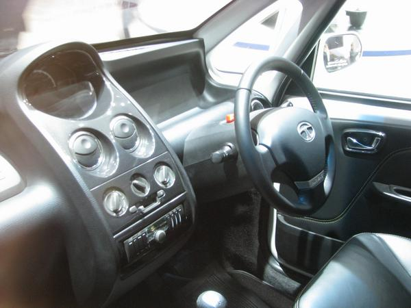 Tata Nano interior 2 airbags, for driver and front seat passenger are today duty.