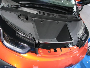 Front luggage compartment of BMW i3 and Tesla S What happens when two completely independent companies develop a new electric car? Both also have a front trunk.